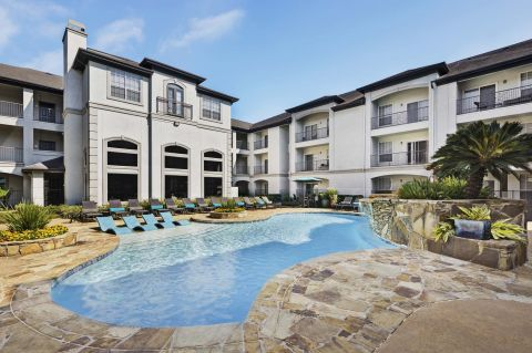 Swimming Pool with Tanning Deck at Camden Midtown Houston Apartments in Houston, TX