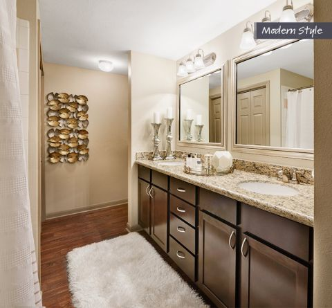 Bathroom with Dual Vanity Sinks at Camden Midtown Houston Apartments in Houston, TX
