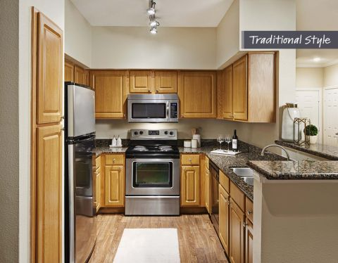 Kitchens with Custom Cabinet and Stainless Appliances at Camden Midtown Houston Apartments in Houston, TX