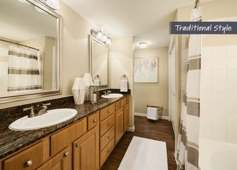 Traditional Style Label Bathroom with Dark Granite Countertops at Camden Midtown Houston Apartments in Houston, TX