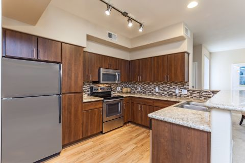 Kitchen with Tiled Backsplash at Camden Montierra Apartments in Scottsdale, AZ