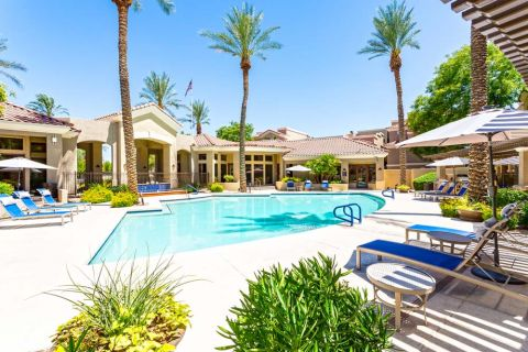 Swimming Pool with Lounge Chairs at Camden Montierra Apartments in Scottsdale, AZ