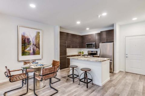 Newly Renovated Kitchen with Kitchen Island and Breakfast Bar at Camden Monument Place Apartments in Fairfax, VA