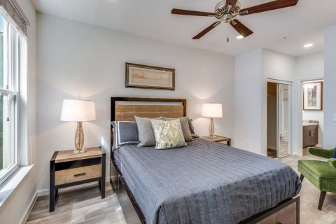 Newly Renovated Spacious Bedroom with Ceiling Fan at Camden Monument Place Apartments in Fairfax, VA