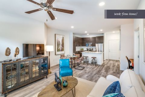 Newly Renovated Kitchen and living room with space to work from home at Camden Monument Place Apartments in Fairfax, VA