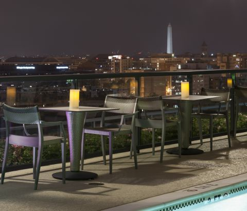 Rooftop Lounge with Nighttime City View at Camden NoMa Apartments in Washington, DC