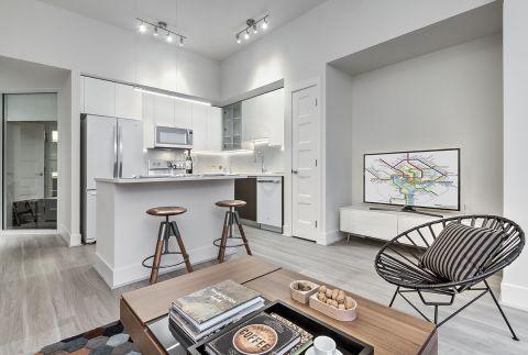 Kitchen with White Ice Appliances, Ceramic Tile Backsplash at Camden NoMa Apartments in Washington, DC