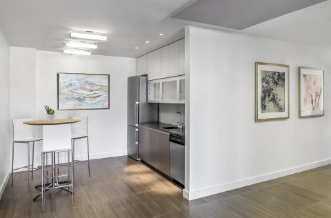 Rooftop Interior Resident Lounge Kitchen at Camden NoMa Apartments in Washington, DC