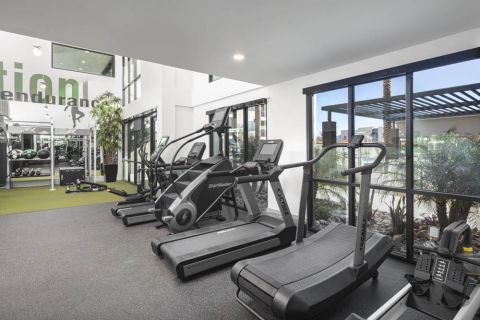 24-hour Fitness Center with Curved Treadmill at Camden North End Apartments in Phoenix, AZ