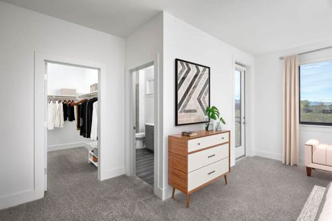 Desert Modern Townhome Bedroom with Ensuite Bath and Walk-In Closet at Camden North End Apartments in Phoenix, AZ