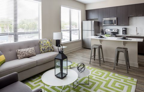 Open Concept Apartment Home with Kitchen Island at Camden North Quarter Apartments in Orlando, Florida