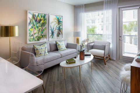 Open Concept Living Room with Hardwood Floors at Camden North Quarter Apartments in Orlando, Florida