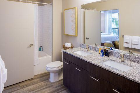 Bathroom with Dual Vanity Sinks at Camden North Quarter Apartments in Orlando, Florida