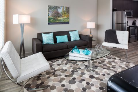Living Room with Entertaining Space at Camden North Quarter Apartments in Orlando, Florida