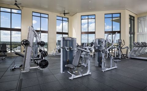 Fitness Center with Cardio Equipment at Camden North Quarter Apartments in Orlando, Florida