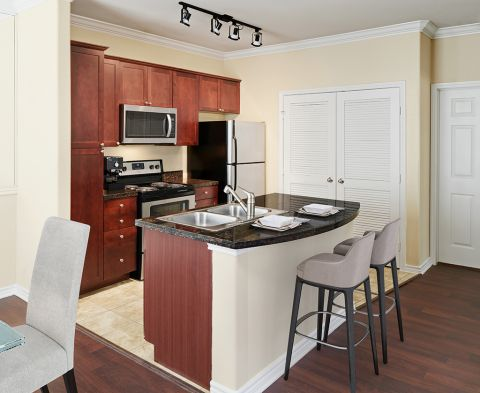 Kitchen with large island at Camden Northpointe Apartments in Tomball, TX