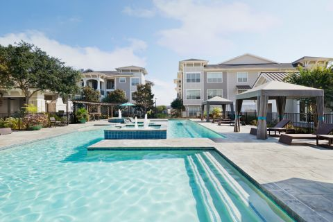 Swimming Pool with Cabanas at Camden Northpointe Apartments in Tomball, Texas