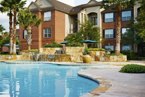 Beach Front Entry Pool with Waterfall at Camden Oak Crest Apartments in Houston, TX