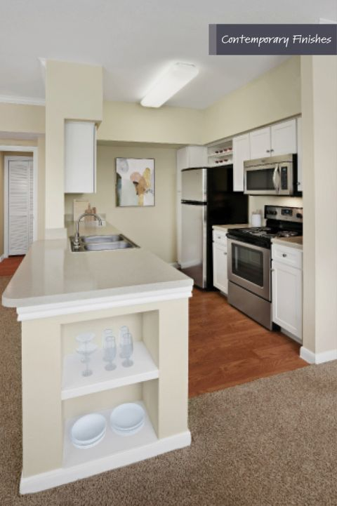 Kitchen with contemporary finishes at Camden Oak Crest Apartments in Houston, TX