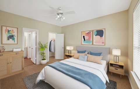Bedroom with walk-in closet at Camden Oak Crest Apartments in Houston, TX