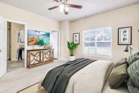 Bedroom and walk-in closet at Camden Overlook Apartments in Raleigh, NC
