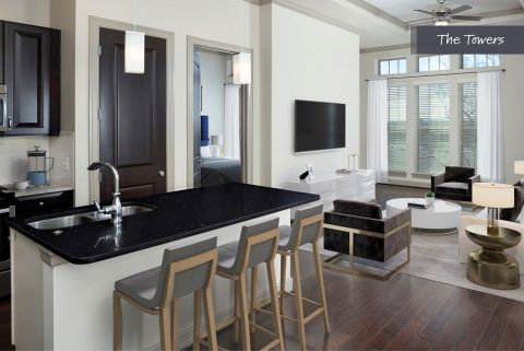 Kitchen and Living Room at The Towers at Camden Paces Apartments in Atlanta, GA