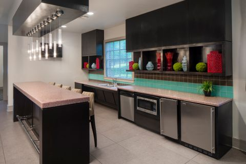 Resident clubroom kitchen at Camden Panther Creek Apartments in Frisco, TX