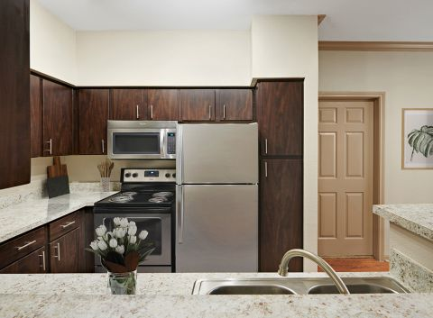 Kitchen with stainless steel appliances at Camden Park Apartments in Houston, TX