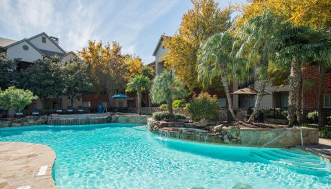 Pool with Fountain at Camden Park Apartments in Houston, TX