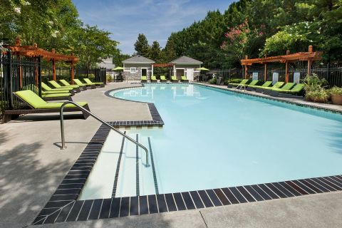 Pool with Sundeck at Camden Peachtree City Apartments in Peachtree City, GA