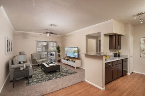 Kitchen and Living Room at Camden Pecos Ranch Apartments in Chandler, AZ