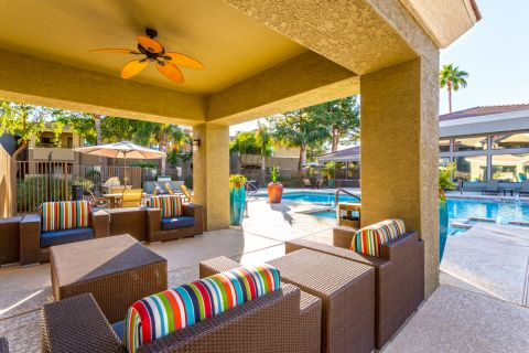 Covered Lounge Poolside at Camden Pecos Ranch Apartments in Chandler, AZ