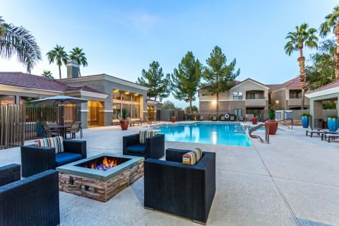 Swimming Pool with Fire Pit and Comfortable Seating at Camden Pecos Ranch Apartments in Chandler, AZ
