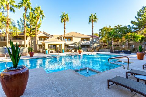 Swimming Pool with Lounge Chairs at Camden Pecos Ranch Apartments in Chandler, AZ