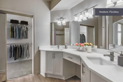 Bathroom and Closet with Modern Finishes at Camden Phipps Apartments in Atlanta, GA