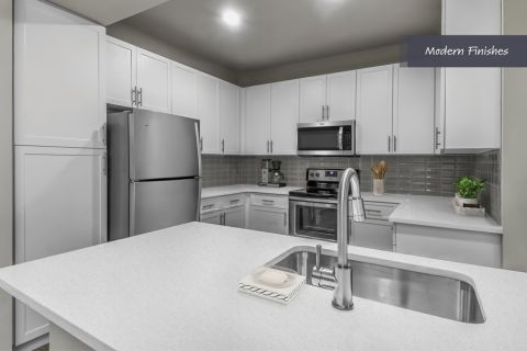 Kitchen with Stainless Steel Appliances and Modern Finishes at Camden Phipps Apartments in Atlanta, GA
