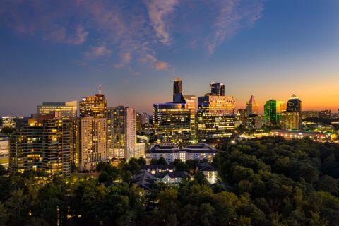 Exterior with Skyline Views at Dusk at Camden Phipps Apartments in Atlanta, GA