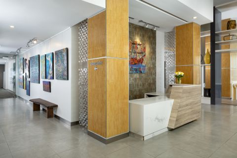 Concierge Lobby and Art Gallery at Camden Pier District Apartments in St. Petersburg, FL