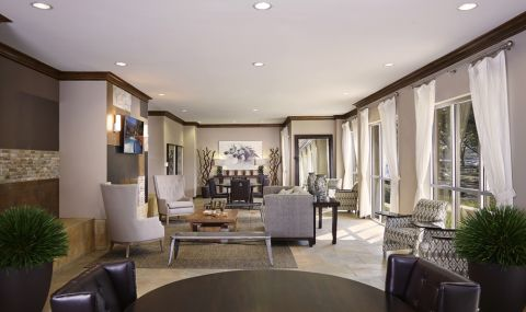Social Lounge with Meeting Space and Poker Tables at Camden Plaza Apartments in Houston, TX