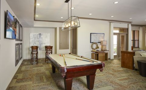 Entertaining Lounge with Kitchen and Billiards at Camden Plaza Apartments in Houston, TX