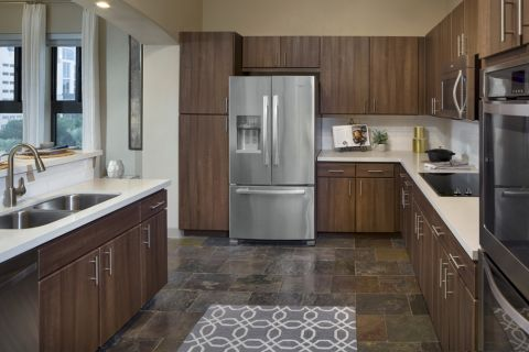 Kitchen with Stainless Steel Appliance at Camden Post Oak Apartments in Houston, TX