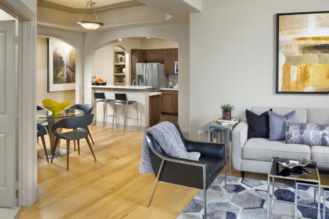 Living Room, Dining Room and Kitchen in Open-Concept Floor Plan at Camden Post Oak Apartments in Houston, TX