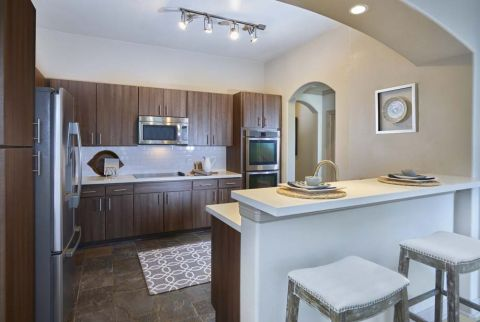 Kitchen with Stainless Steel Appliances at Camden Post Oak Apartments in Houston, TX