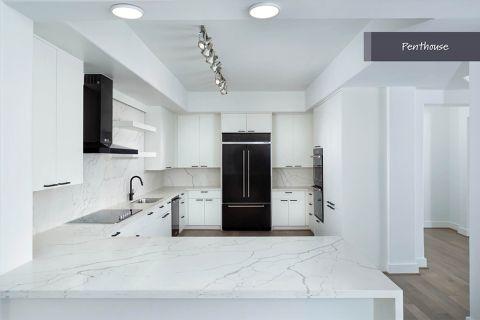 Penthouse Kitchen at Camden Post Oak Apartments in Houston, TX