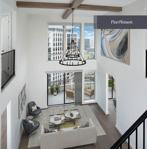 Penthouse Living Room with Floor to Ceiling Windows at Camden Post Oak Apartments in Houston, TX