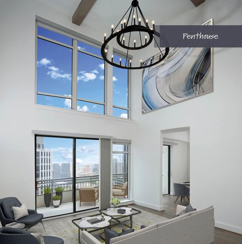 Penthouse Living Room with Galleria Views at Camden Post Oak Apartments in Houston, TX