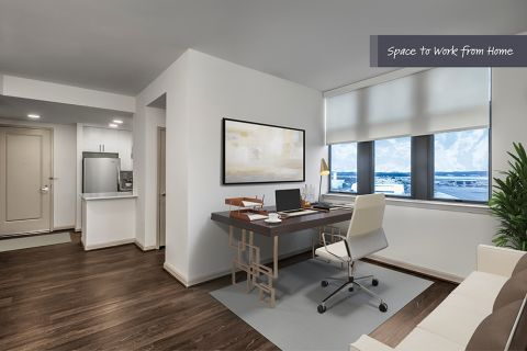 Modern living room with home office space at Camden Potomac Yard Apartments in Arlington, VA