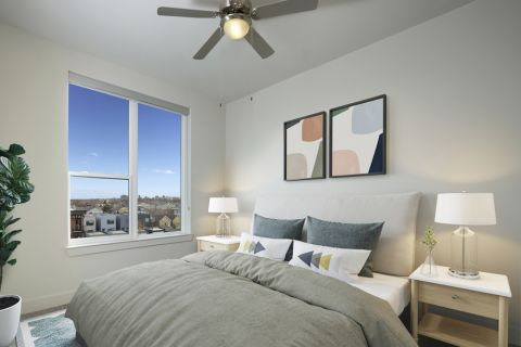 Bedroom with city views at Camden RiNo apartments in Denver, CO