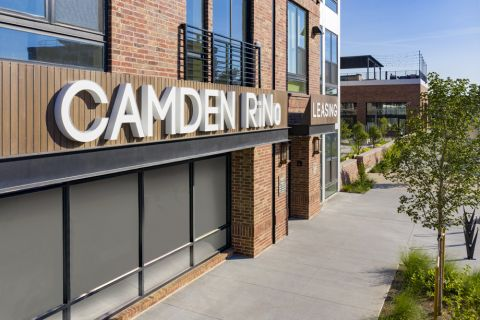 Exterior signage at Camden RiNo apartments in Denver, CO