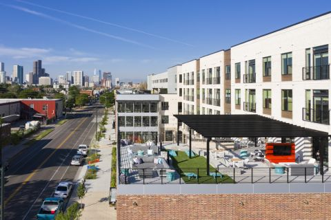 Exterior and outdoor lounge at Camden RiNo apartments in Denver, CO